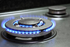 Gas stove. Flames of gas stove burning royalty free stock photography