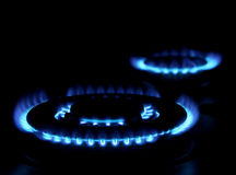 Gas stove. Flames of gas stove in the dark royalty free stock image