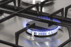 Gas stove. A flame on the gas burner on a stove Stock Image