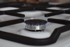 Gas stove, blue fire. The use of domestic gas for domestic purposes stock images