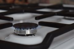 Gas stove, blue fire. The use of domestic gas for domestic purposes stock photos