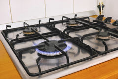 Gas stove. With blue flame in the kitchen Royalty Free Stock Images