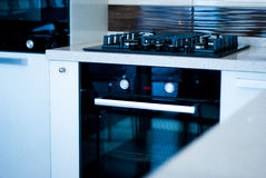 Gas stove. Brand new gas stove in the modern kitchen Stock Photos