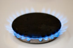 Gas-stove burner. Natural gas burner blue flames royalty free stock photos