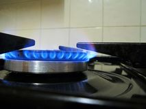 A gas stove burner with blue flames Stock Image