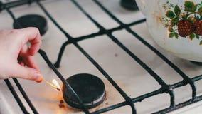 Gas stove burner igniting, burning stock video