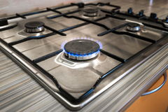 Gas stove close up on the home kitchen. Steel color. Burning gas Royalty Free Stock Images