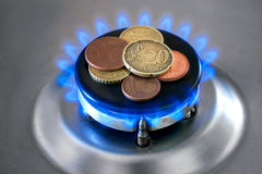 Gas stove with coins. Stock Images