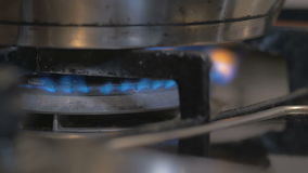 On a gas stove is cooked in the pot soup. the broth is boiling, brewing. beautiful shot with soft focus. stock video footage