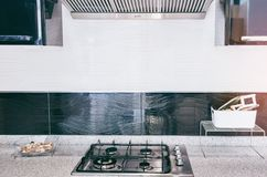 Gas stove with and embedded electric oven at brand new modern white kitchen stock photography