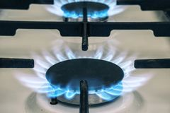Gas stove flame on kitchen. Blue fire flame from stove.  Royalty Free Stock Image