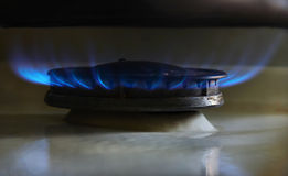 Gas, stove. Stove, kitchen burner, gas burning blue flame Stock Photos