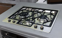Gas stove top. Close up of modern gas stainless steel stove top -cooktop Royalty Free Stock Photo