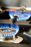 Gas stove with two burning blue flames. Two burning blue flames of a gas stove stock images