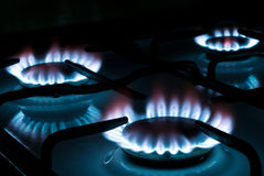 Gas stove V1. Three flames burning on a gas stove in the kitchen Royalty Free Stock Photography