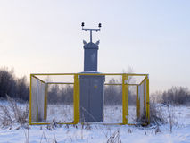 Gas substation. Fenced gas substation in the woodland, winter time royalty free stock photo