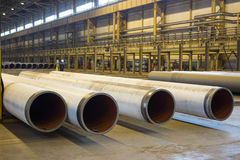 Gas supply pipes of large diameter are stacked in workshop Stock Image