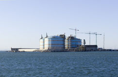 Gas tank. Isolated liquified natural gas storage tanks at the port Stock Image
