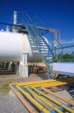 Gas tank. White gas propane tank with stairs and gas pipes Stock Image