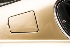 Gas tank filler cap. Golden gas tank filler cap on an old classic sports car stock photos