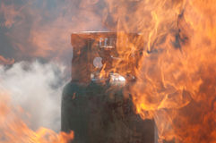 Gas tank in the storm fire. Stock Photos