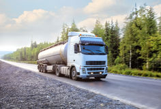 Gas-tank truck goes on highway Stock Photo