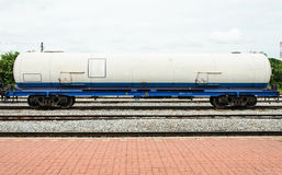 Gas tanker. In freight train at station Stock Photo