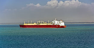 Gas tanker at Suez canal northbound. Gas tanker LNG transporting  liquefied natural gas sea Stock Image