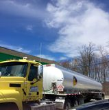 Gas Tanker Truck. Dropping of fuel to gas station Royalty Free Stock Photo
