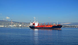 Gas tanker. View of an anchored gas tanker. Oil and Gas industry at the background Stock Photography