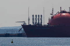 Gas terminal and tanker. Transport of natural gas to the LNG terminal in Swinoujscie - Poland Stock Photos