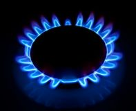 Gas torch. (ring) with a dark blue flame stock photo