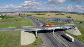Gas truck driving on the bridge. Aerial. Gas truck on the road stock footage