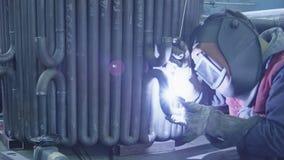 Gas tungsten arc welding. Welding a steel pipes. Gas tungsten arc welding close up stock video