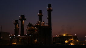 Gas turbine electrical power plant at dusk stock video footage