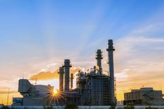 Gas turbine electrical power plant at dusk with twilight support all factory in industrial Estate stock image