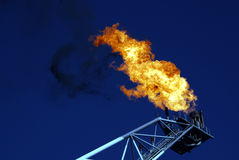 Gas Vent Flare. Unusable gas flares from an offshore oil & gas rig Stock Image