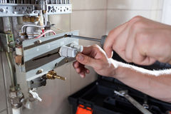 Gas water heater reparation Stock Photo