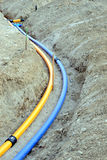 Gas- and waterpipes. Laying of natural gas pipelines and potable water lines Royalty Free Stock Image