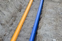 Gas- and waterpipes. Laying of natural gas pipelines and potable water lines Stock Photos