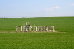 Gas Well. In the green box and blue sky Stock Images