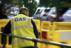 Gas worker in city center Royalty Free Stock Image