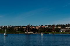 View of Gas Works Park in Seattle from Lake Union. Gas Works Park in Seattle, Washington, is a 19.1-acre public park on the site of the former Seattle Gas Light Royalty Free Stock Image