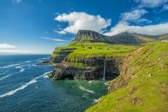 Gasadalur village and  Beautiful  waterfall, Sunny Day, Vagar, Faroe Islands, Denmark