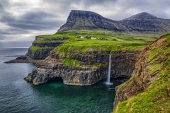 Gasadalur village and Beautiful waterfall,Vagar, Faroe Islands stock photography
