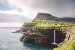Gasadalur village and Beautiful waterfall. Vagar, Faroe Islands, Denmark