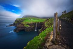 Gasadalur village and Mulafossur waterfall on Faroe Islands, Denmark