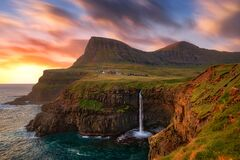 Gasadalur Waterfall into the Ocean in Faroe Islands