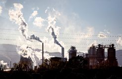 Gases steam and smoke coming from industrial site Stock Photo