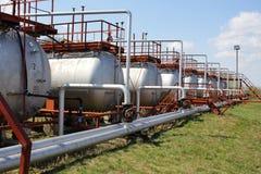 Gasflessen (opslagtanks) Stock Foto